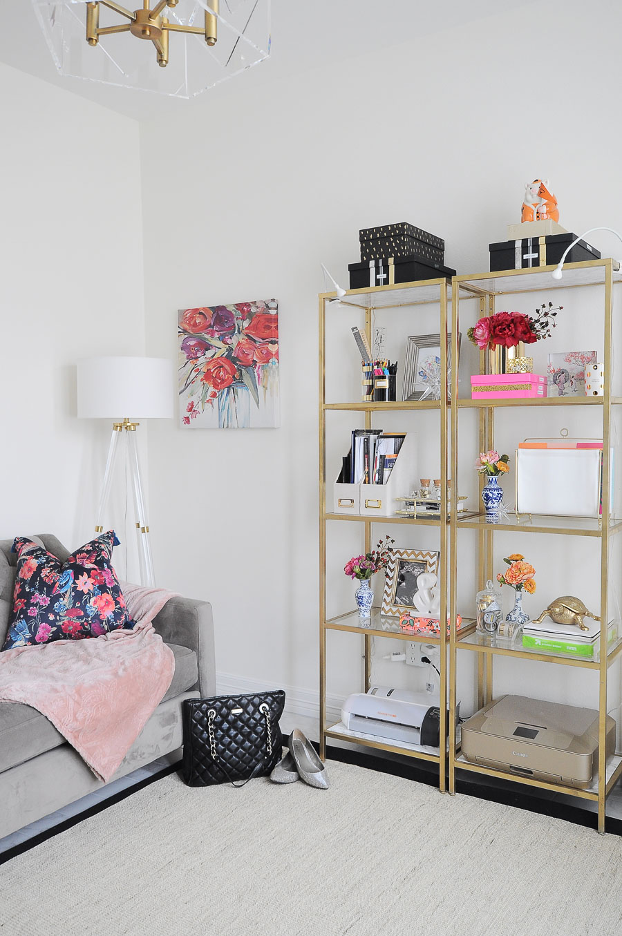 Stylish VITTSJOS spray painted gold hold decor and craft supplies in this bright white and floral home office space.