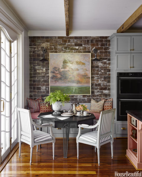 Ken Fulk cozy dining nook banquette exposed brick New Orleans