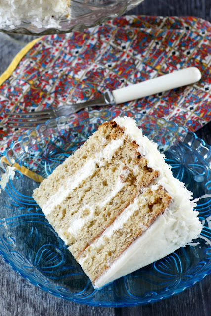 close up of slice of star spangled banana cake with colorful napkin and fork