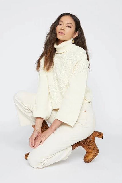 Model in a white turtleneck knit sweater from Sway & Cake Seattle