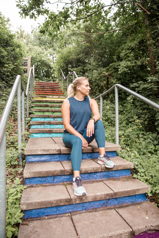 Rachel Emily on Rainbow steps in matching green running wear