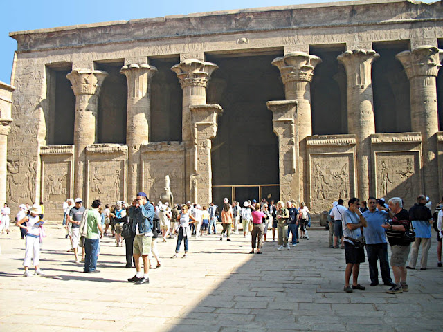 Tourists milling about outside the Edfu temple