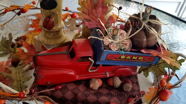 Pumpkins, Spindles, and Vintage Truck Share NOW. #falldecor. #fallvignette #pumpkins #vinatge #eclecticredbarn