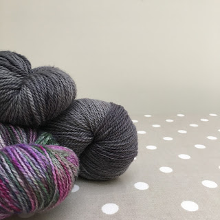 Photograph of three skeins of yarn