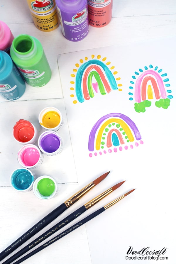 These rainbows are so cute and have such a playful vibe to them. Use the stick end of the paintbrush for round dots if desired. Then let the paint dry completely.