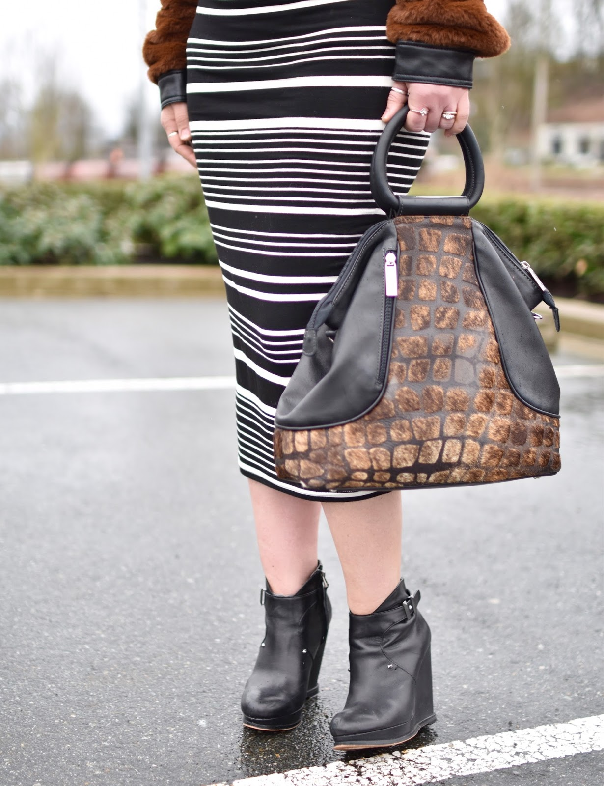 Monika Faulkner outfit inspiration - striped midi-length pencil skirt, black wedge booties, ring-handle bag