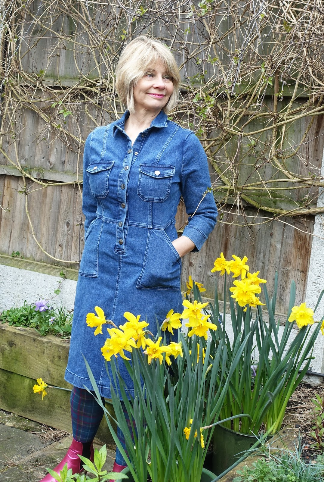 Ageing gracefully over 50:  style blogger Gail Hanlon in denim dress and tartan tights