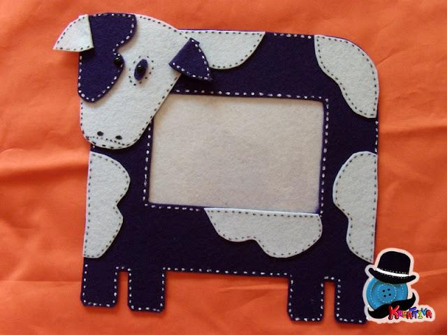 Cornice mucca in feltro per foto bambini