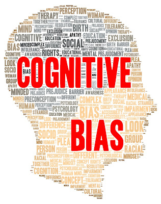 Illustration of the outline of a head filled with words describing cognitive bias.
