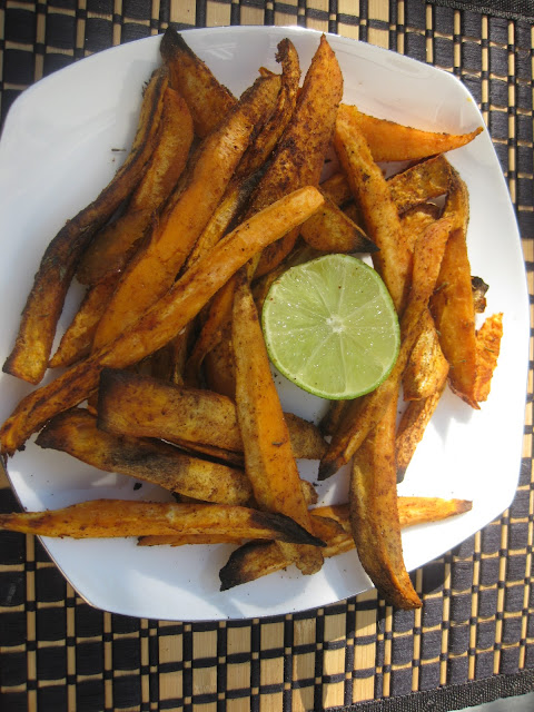 sweet potato fries on a plate with a lime