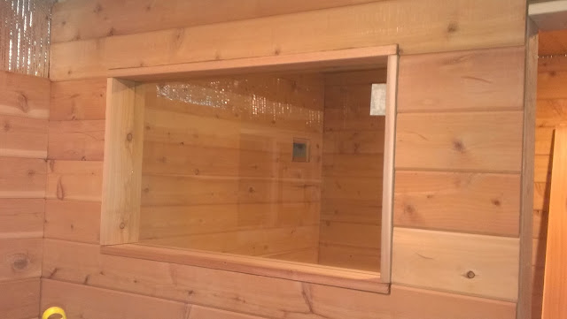Sauna candle window installed and framed.
