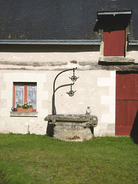 Well in a garden, Sainte Catherine de Fierbois, Indre et Loire, France. Photo by Loire Valley Time Travel.