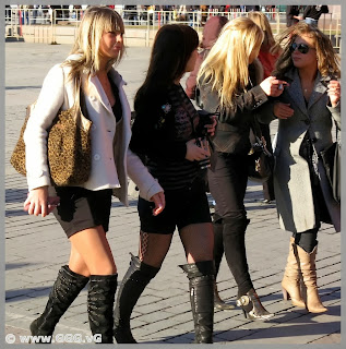 Girls in leather boots on the street
