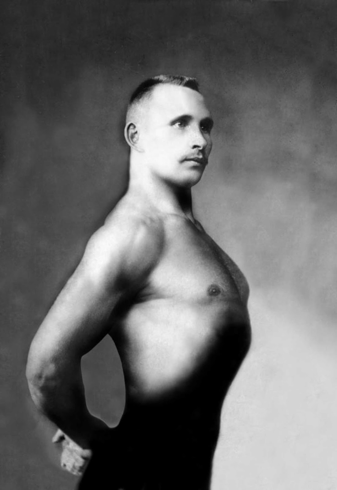 A Russian bodybuilder, photographed in a studio circa 1900.