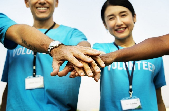 volunteers hands together