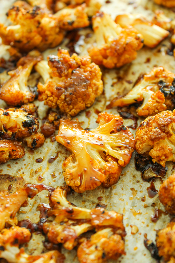 Sweet and Spicy Baked Cauliflower-Keep it simple with this oven-roasted side dish. Cauliflower florets are tossed in an irresistible sweet and spicy marinade and baked until tender.