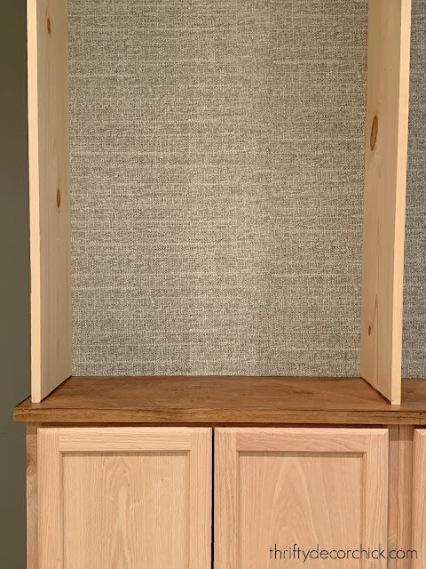 Gray tweed wallpaper on bookcases