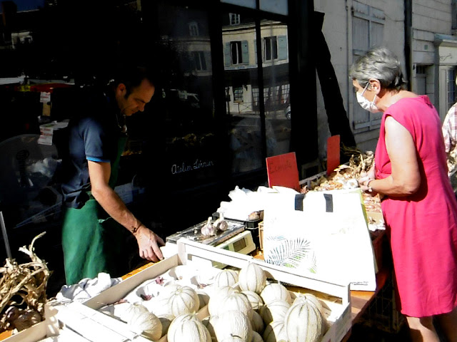 Buying garlic at the market. Indre et Loire. France. Photo by Loire Valley Time Travel.