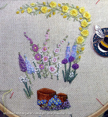 Blue and purple flowers added to front of embroidered scissors keeper