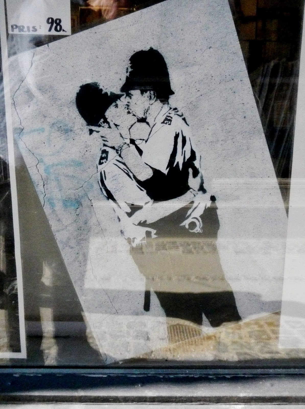 cops kissing Banksy painting