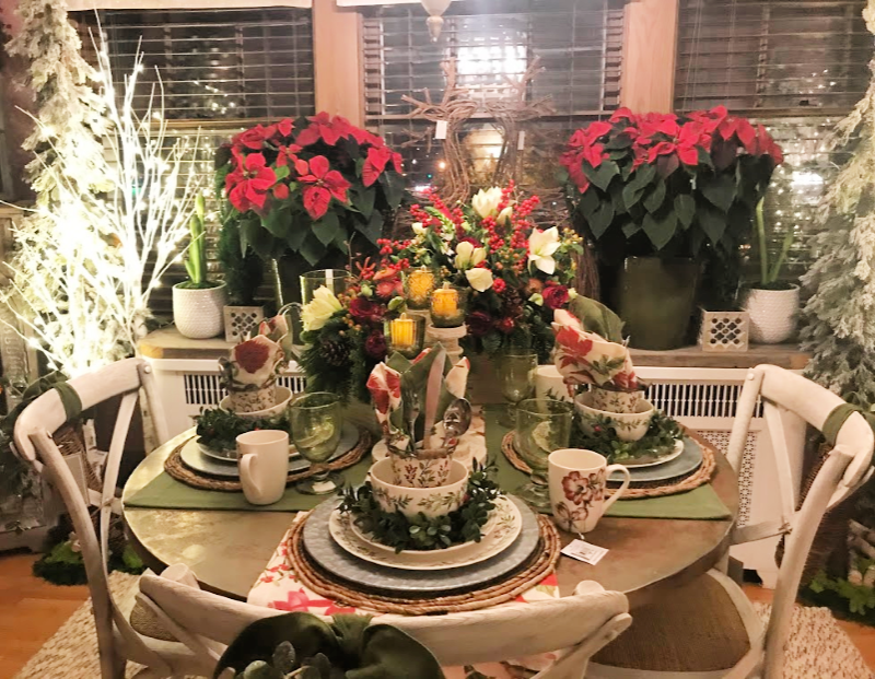 a Christmas dining room table with poinsettias