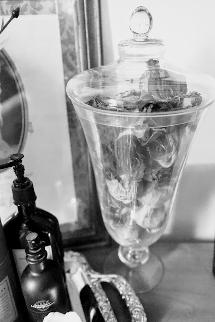 Roses in apothecary jar