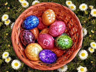 Easter baskets containing fake Easter grass, chocolate, and other candies are potential hazards for cats.