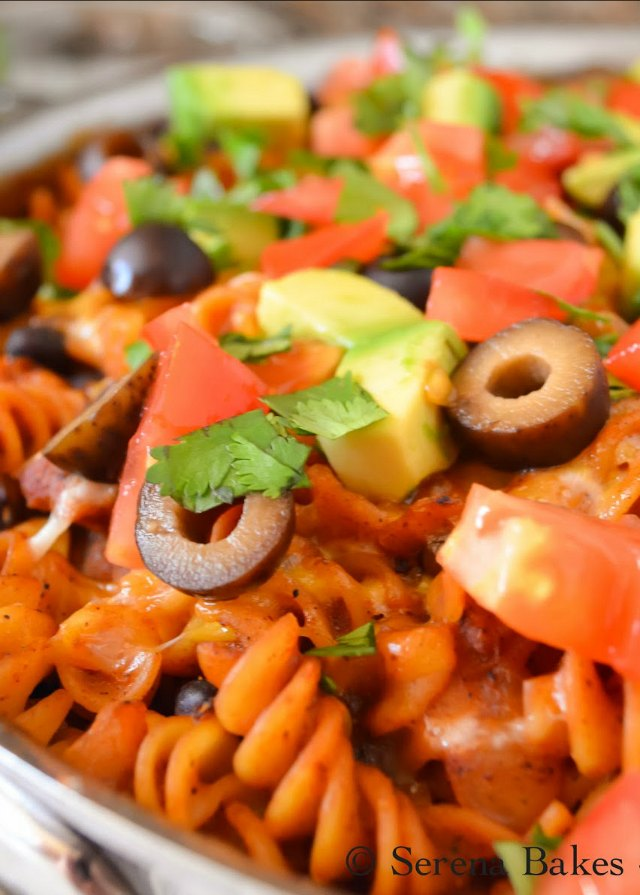 Chicken Enchilada Pasta is an easy one Skillet dinner recipe using chicken breast perfect for a busy weeknight from Serena Bakes Simply From Scratch.