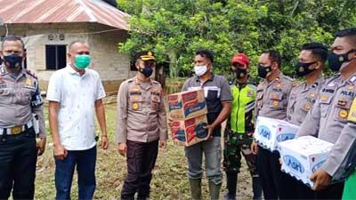 Polres Dharmasraya Bantu Korban Banjir di Kapalo Koto