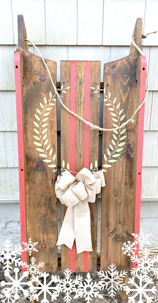 Wooden sled with a wreath