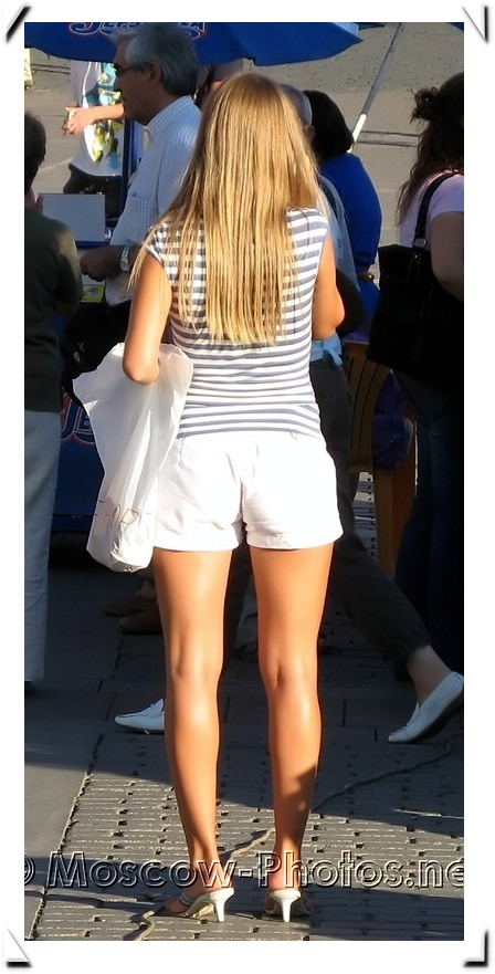 Moscow street fashion - girl in white shorts