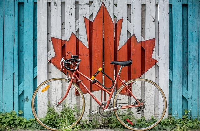 bike on a wall with maple leaf sign