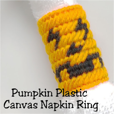 With a short Netflix binge night, you can sew up a whole set of these plastic canvas napkin rings perfect for your Halloween dinner table.  These pumpkin face napkin rings are perfect to use at your Halloween party year after year.  #pumpkin #halloween #plasticcanvas #napkinring #diypartymomblog
