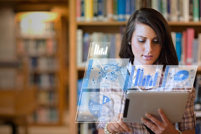 photo of girl using tablet in library with bar charts and graphs super imposed around her