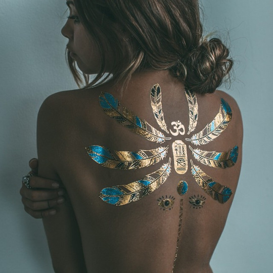 Amazing Gold Tattoo On Back