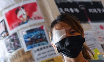 Hong Kong to defend China with 'one eye'