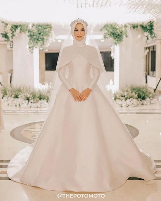 فستان زفاف للمحجبات بشكل غير تقليدية باطلالة ملائكية موديل 2020