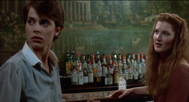 Irena Gallier (Nastassja Kinski) and Alice Perrin (Annette O' Toole) at Cliff's Bar in CAT PEOPLE (1982).