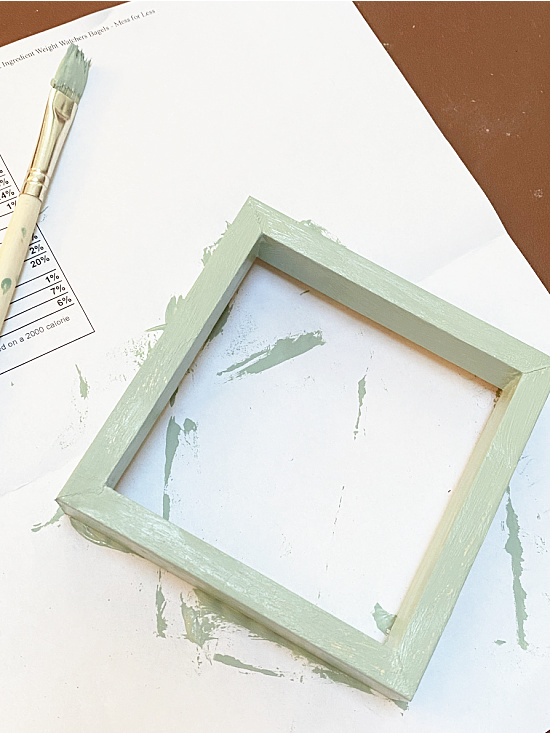 green painted and distressed frame