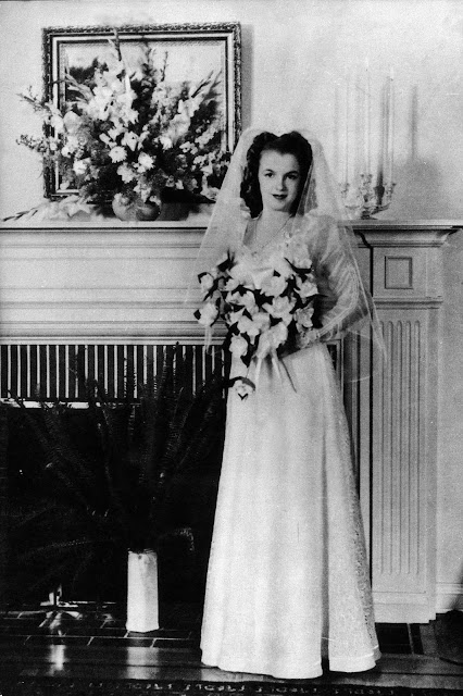 The wedding was officiated by a minister, Norma Jeane wore an embroidered lace wedding dress with long sleeves and veil.