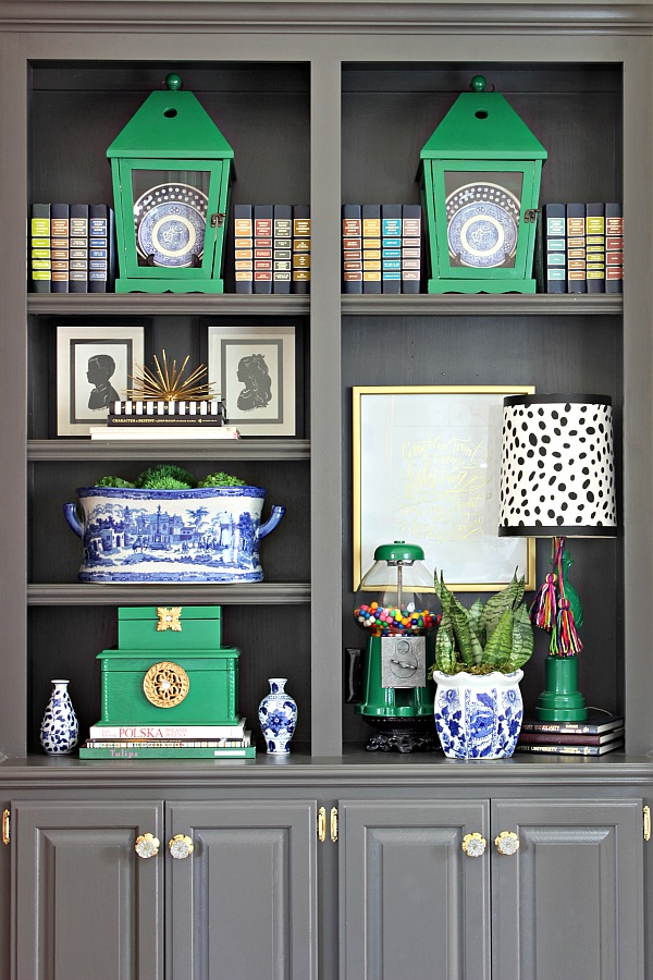 bookshelf styling, how to style shelves, lanterns, Reader's Digest books, silhouettes