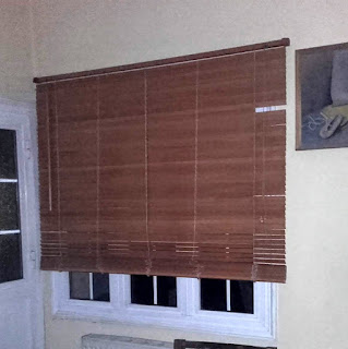 broken blind over a window