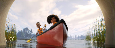 Still from PIXAR's animated film Loop. A Black teen boy and girl are seated in a red canoe together. The boy is holding a paddle.