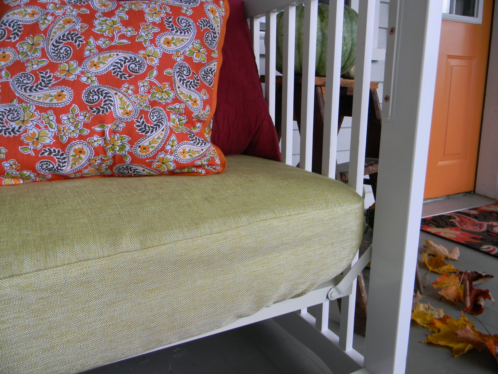 Baby crib turned front porch daybed.