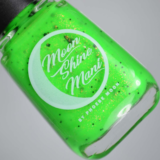 neon green nail polish with black glitter in a bottle