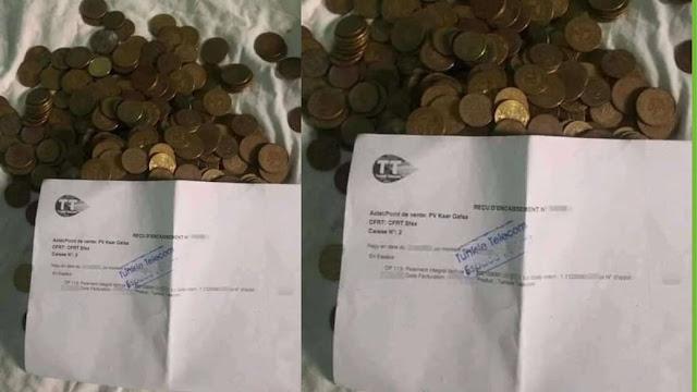 مواطن يقوم بدفع فاتورة الانترنت بقطع نقدية  من فئة 20 الى 50 مليم و السبب غريب !