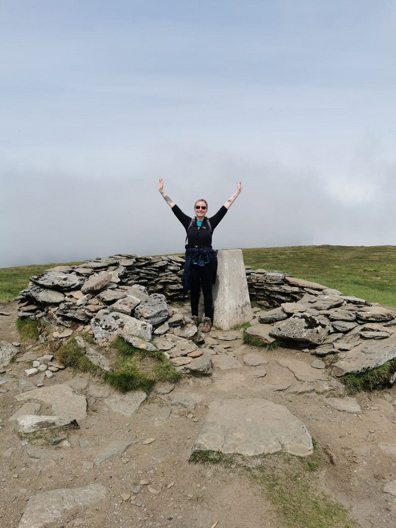 Arms in the air, at the summit of Ben Wyvis