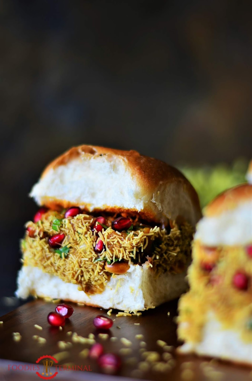 Step by step dabeli recipe-indian street food, all garnished with pomegranate seeds and dusted with sev.
