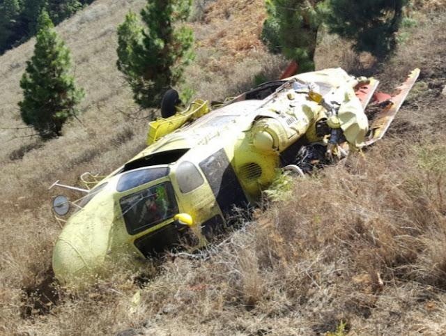 Tripulación helicóptero caído en la palma en buen estado