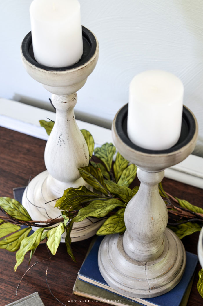Pair of painted candleholders with greenery